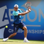 Bernard Tomic in action during his first round victory over Tim Smyczek at the ATP Queen's Club event in London; Getty Images