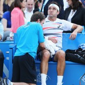 Marinko Matosevic received treatment during his third round match against Jo-Wilfried Tsonga at the ATP Queen's Club event in London; Getty Images