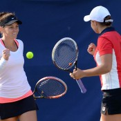 Ash Barty (R) and Casey Dellacqua celebrate their first-round doubles victory over Timea Babos and Kristina Mladenovic at the WTA Birmingham event; Christopher Levy