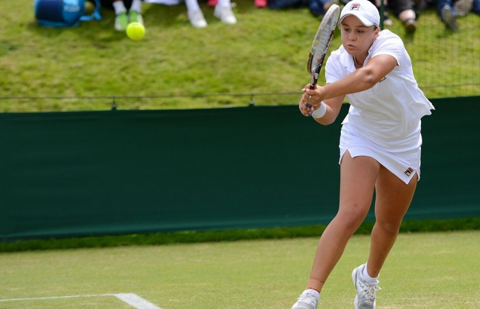 Ash Barty plays a backhand en route to victory over Lyudmyla Kichenok of Ukraine in the second round of Wimbledon qualifying at Roehampton; Christopher Levy