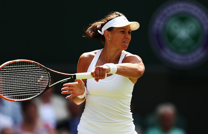 Casey Dellacqua in action on Centre Court during her second round loss to No.4 seed Agnieszka Radwanska; Getty Images