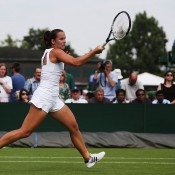Jarmila Gajdosova plays a forehand en route to victory over Swiss Stefanie Voegele in the first round at Wimbledon; Getty Images