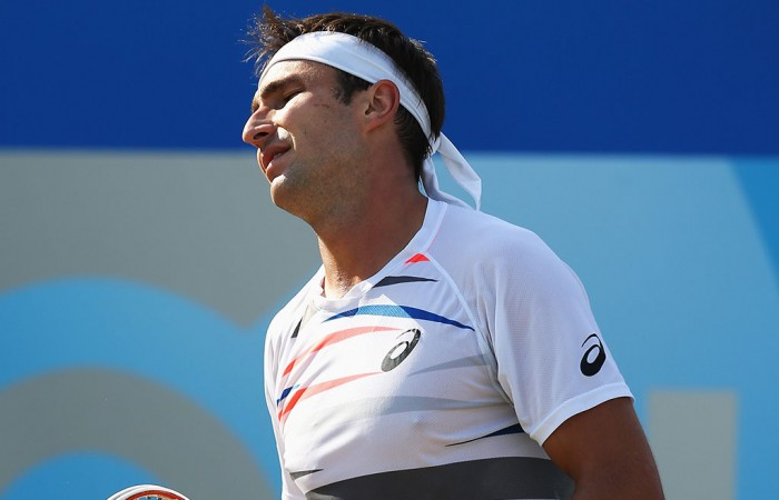 Marinko Matosevic shows his frustration during his quarterfinal defeat to Stan Wawrinka at the ATP Queen's Club event in London, England; Getty Images