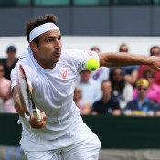 Marinko Matosevic stretches for a volley during his five-set second-round loss to Jeremy Chardy of France at Wimbledon; Getty Images