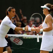 Sam Stosur (R) and Italian partner Flavia Pennetta in action in their first round women's doubles victory; Getty Images