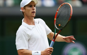 Luke Saville in action during his second round loss to 11th seed Grigor Dimitrov on Centre Court at Wimbledon; Getty Images