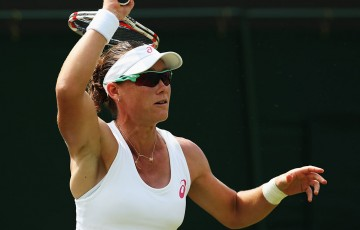 Sam Stosur plays a forehand during her first round loss to Belgian Yanina Wickmayer at the 2014 Wimbledon Championships; Getty Images
