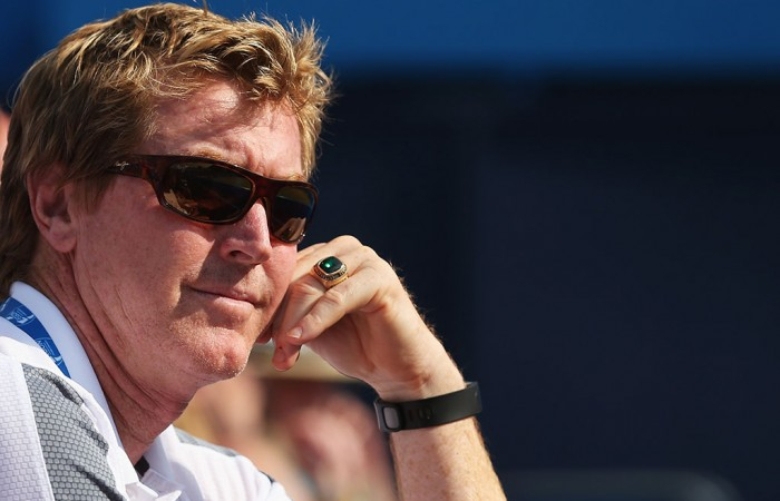 Mark Woodforde watches Marinko Matosevic in action; Getty Images