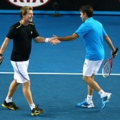 Mark Woodforde (L) and Todd Woodbridge in action during the legend's doubles event at Australian Open 2014; Getty Images