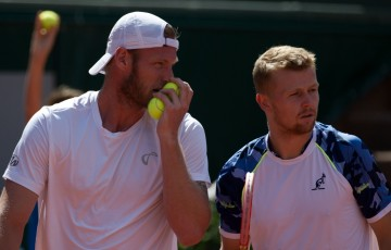 Sam Groth (L) and Andrey Golubev in action during their men's doubles semifinal at Roland Garros, Paris, France; Elizabeth Xue Bai