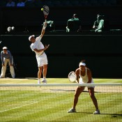 Casey Dellacqua (at net) and Jamie Murray in action during their third round mixed doubles victory over Horia Tecau and Sania Mirza on Centre Court at Wimbledon; Getty Images