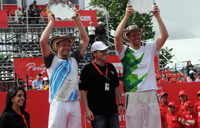 Sam Groth (L) and Chris Guccione (R) pose with their trophies after capturing the doubles title at the ATP event in Bogota; Claro Open Colombia