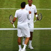 Nick Kyrgios (facing camera) shakes hands with Milos Raonic after falling to the Canadian in the Wimbledon quarterfinals; Getty Images