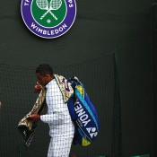 Nick Kyrgios exits No.1 Court at Wimbledon after falling to Milos Raonic in the 2014 quarterfinals; Getty Images