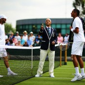 Nick Kyrgios (R) prepares to take on Frenchman Stephane Robert in the opening round of the 2014 Wimbledon Championships; Getty Images