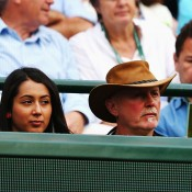 Nick Kyrgios' sister Halimah (L) and his father George watch him in action against Milos Raonic in the quarterfinals of WImbledon; Getty Images
