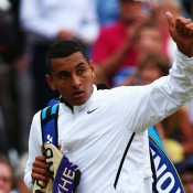 Nick Kyrgios acknowledges the No.1 Court crowd at Wimbledon after falling to Milos Raonic in the 2014 quarterfinals; Getty Images