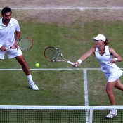 Sam Stosur (R) and Nenad Zimonjic in action in the Wimbledon mixed doubles event; Getty Images