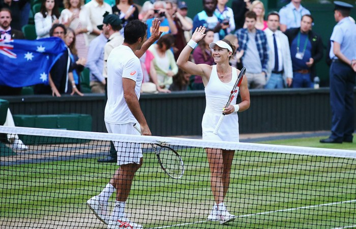 Sam Stosur (R) and Nenad Zimonjic celebrate winning the Wimbledon mixed doubles title over Max Mirnyi and Hao-Ching Chan; Getty Images
