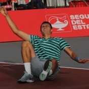 Bernard Tomic celebrates winning match point to clinch the ATP Bogota event; Claro Open Colombia