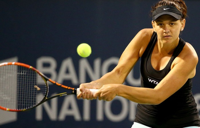 Casey Dellacqua in action during her second round loss to No.2 seed Petra Kvitova at the WTA Rogers Cup in Montreal; Getty Images