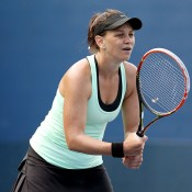 Casey Dellacqua prepares to return serve during her US Open first round victory against Patricia Mayr-Achleitner; Getty Images