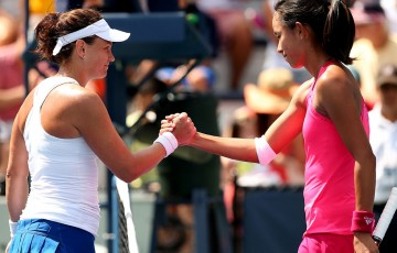 Casey Dellacqua (L) shakes hands with Qiang Wang after winning their second round match at the US Open; Getty Images
