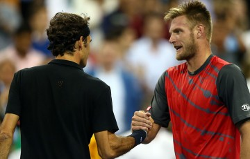 Sam Groth (R) shakes hands with Roger Federer after falling to the Swiss in the second round of the US Open; Getty Images