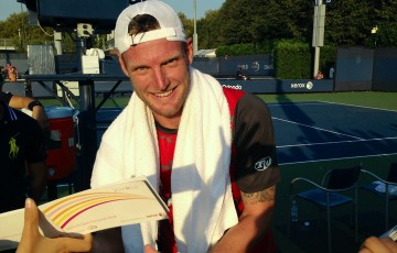 Sam Groth signs autographs for fans after his first-round victory over Albert Ramos-Vinolas at the US Open in New York; Getty Images