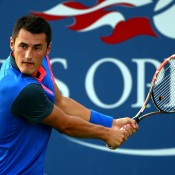 Bernard Tomic plays a backhand en route to a first-round victory over Dustin Brown at the US Open; Getty Images