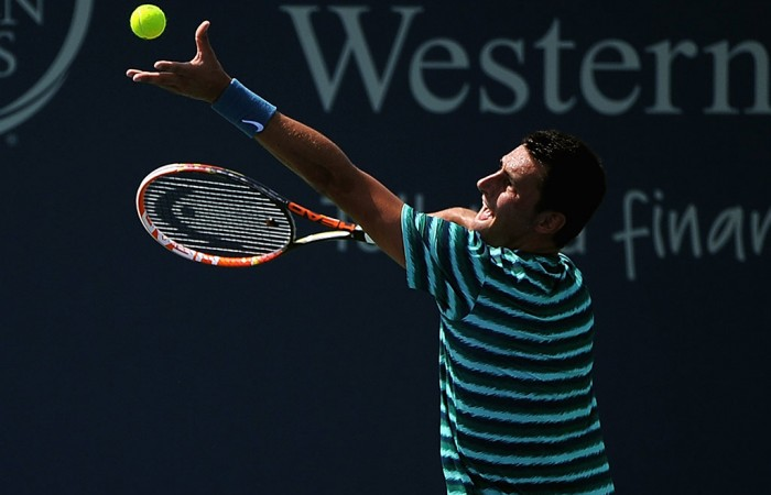 Bernard Tomic in action at the ATP Cincinnati Masters; Getty Images