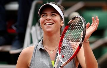 Ajla Tomljanovic celebrates her defeat of No.3 seed Agnieszka Radwanska in the third round at Roland Garros; Getty Images
