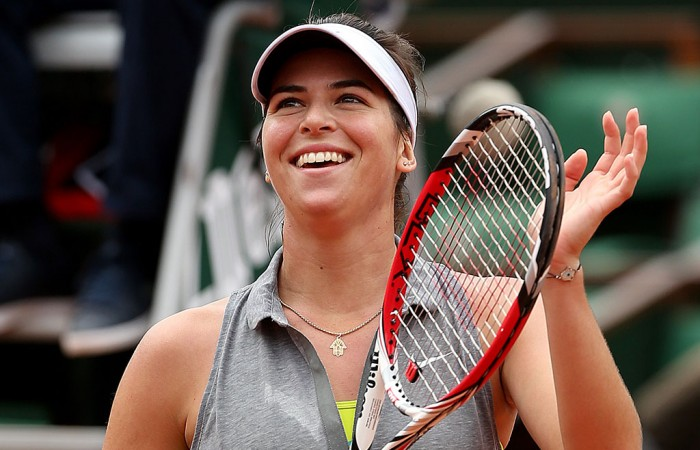 Ajla Tomljanovic celebrates her defeat of No.3 seed Agnieszka Radwanska in the third round at Roland Garros; Getty Images