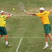Lleyton Hewitt (L) and Chris Guccione in Davis Cup doubles action; Getty Images