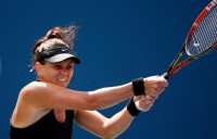 Casey Dellacqua in action during her US Open fourth-round loss to 11th seed Flavia Pennetta on Arthur Ashe Stadium; Getty Images