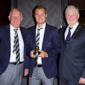 Lleyton Hewitt (centre) receives his Davis Cup Commitment Award from Tony Roche (L) and Geoff Pollard; Tennis Australia