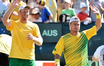 Chris Guccione (L) and Lleyton Hewitt celebrate after sealing Australia's 3-0 Davis Cup victory over Uzbekistan in the World Group Play-offs at Cottesloe Tennis Club; Getty Images