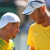 Lleyton Hewitt (L) and Chris Guccione in Davis Cup doubles action in the World Group Play-off tie against Uzbekistan in September 2014 in Cottesloe; Getty Images