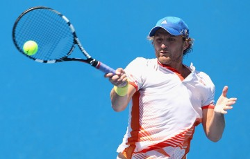 Matt Reid in action during the Australian Open 2014 qualifying event; Getty Images