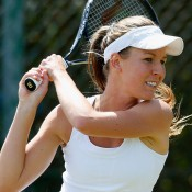 Olivia Rogowska in action during Wimbledon 2014 qualifying; Getty Images