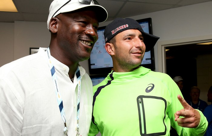 Marinko Matosevic (R) poses with basketball legend Michael Jordan following his first round loss to Roger Federer at the US Open; Getty Images