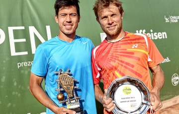 Jason Kubler (L) poses with the winner's trophy after defeating Radu Albot (R) in the final of the 2014 Sibiu Open ATP Challenger event; Silvana Armat/Sibiu Open