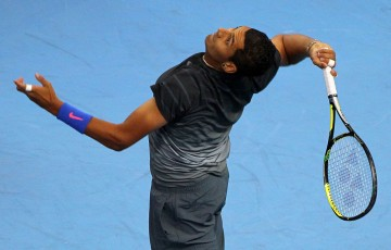 Nick Kyrgios serves during the ATP Malaysian Open in Kuala Lumpur; Getty Images