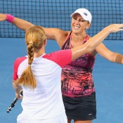 Anastasia Rodionova (R) and Russian partner Alla Kudryavtseva celebrate winning the Brisbane International title in 2014; Getty Images
