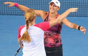 Anastasia Rodionova (R) and Russian partner Alla Kudryavtseva celebrate winning the Brisbane International title in 2014; Getty Images