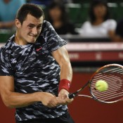 Bernard Tomic plays a backhand in his first round loss to Milos Raonic at the ATP Japan Open in Tokyo; Getty Images