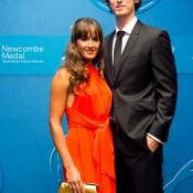 Arina Rodionova (L) and Ty Vickery on the blue carpet at the 2014 Newcombe Medal Australian Tennis Awards; Elizabeth Xue Bai