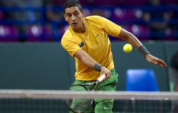 Nick Kyrgios from Australia in action during men's doubles during the Davis Cup match between Poland and Australia at the Torwar Hall on September 14, 2013 in Warsaw, Poland. (Photo by Adam Nurkiewicz/Getty Images)