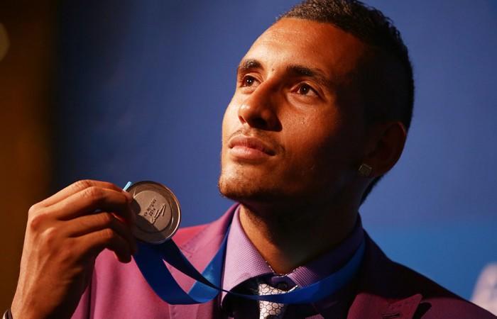 Nick Kyrgios wins the 2014 Newcombe Medal; Fiona Hamilton