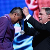 Nick Kyrgios (L) is presented with the 2014 Newcombe Medal by tennis legend John Newcombe; Getty Images